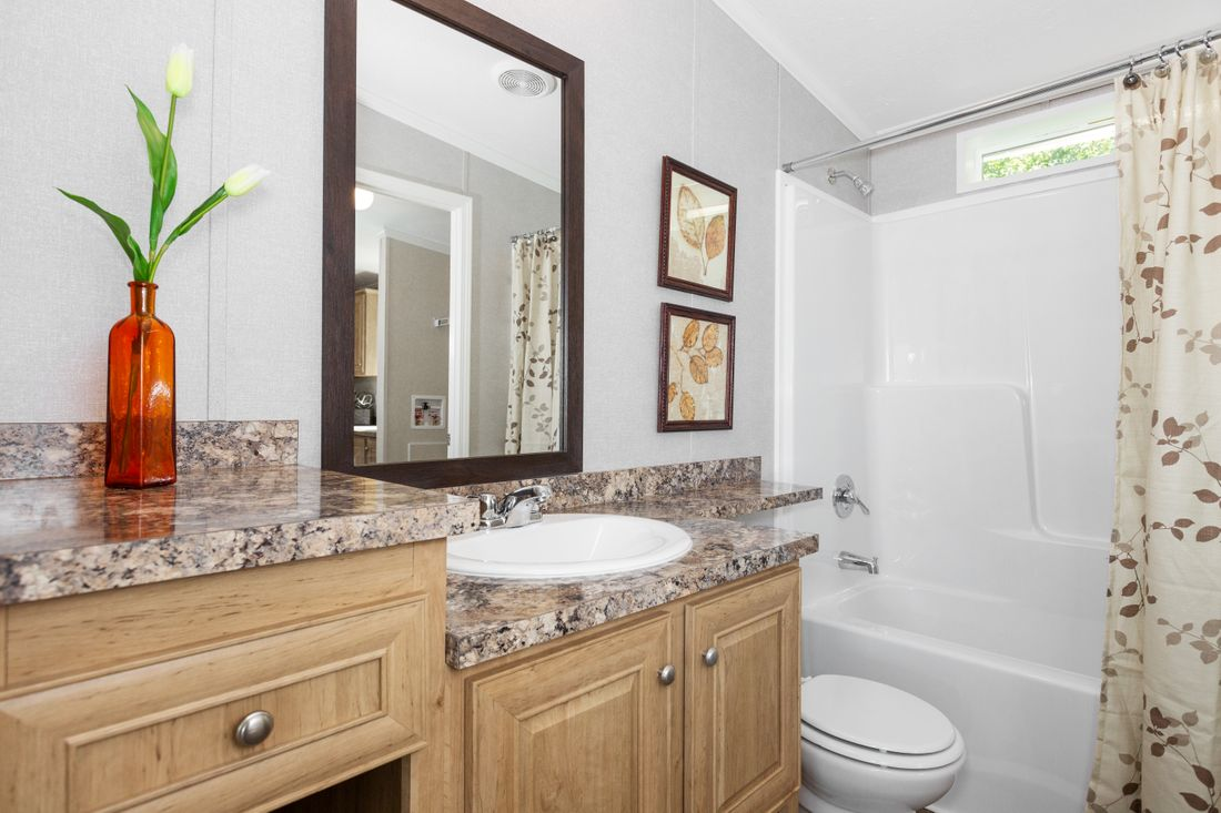 The SHEER ELM Guest Bathroom. This Manufactured Mobile Home features 3 bedrooms and 2 baths.