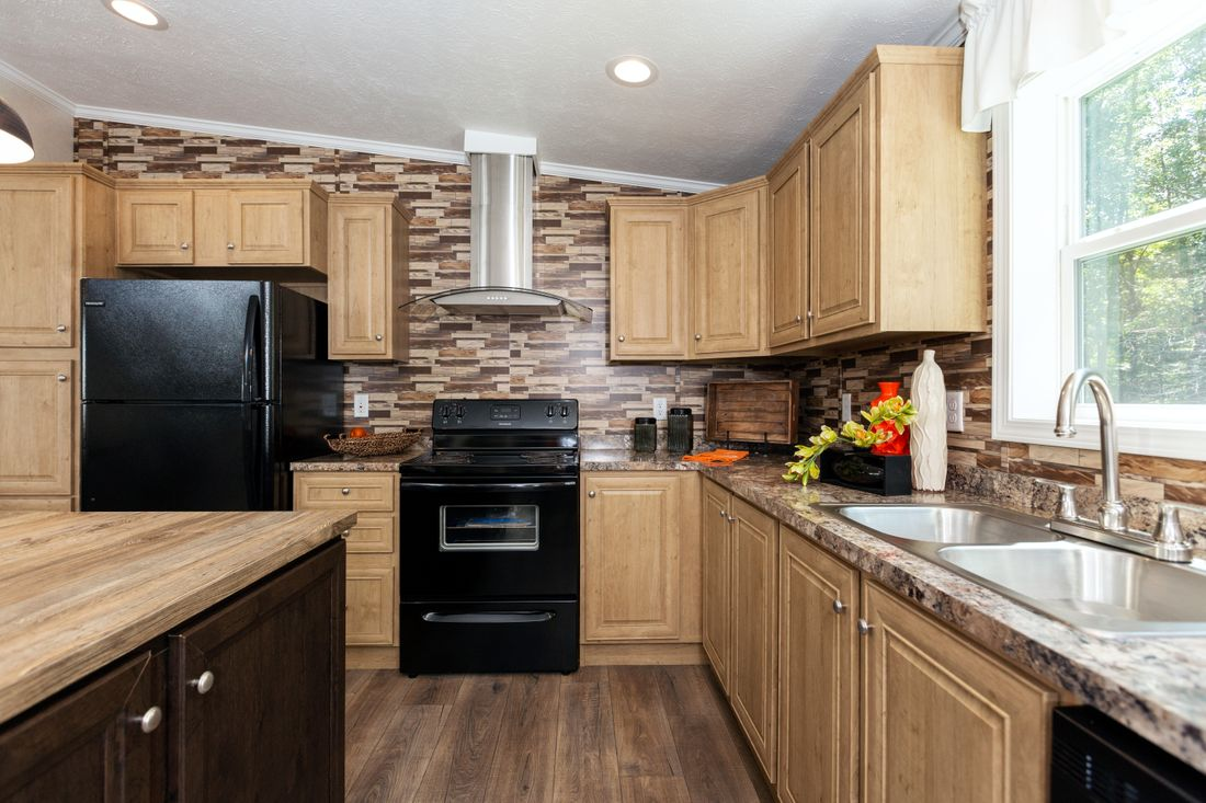 The SHEER ELM Kitchen. This Manufactured Mobile Home features 3 bedrooms and 2 baths.