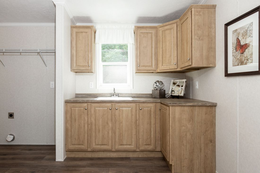 The SHEER ELM Utility Room. This Manufactured Mobile Home features 3 bedrooms and 2 baths.